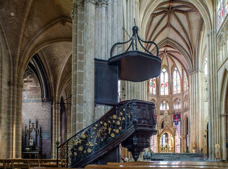 nave: Bayonne, France - May 21, 2016: Apse and pulpit in nave of Cathedral of Sainte-Marie de Bayonne Cathedral.  Bayonne, Aquitaine. France