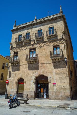 castille: Motorcycle in front of principal facade of Casa de los Cueto in Ciudad Rodrigo, Salamanca, Castilla y Leon. Spain.