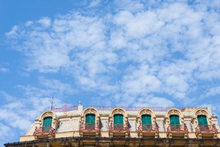 roof windows: Windows of a attics roof in a european classic building under a blue sky.