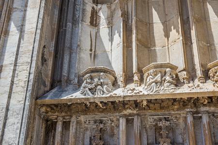portico: Detail of gothic portico in south facade of Santa Maria cathedral. Gerona, Costa Brava, Catalonia, Spain.