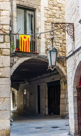 separatist: Flag of independence movement of Catalonia, called Estelada (unofficial), in a street of the downtown of Girona, Costa Brava, Catalonia, Spain.