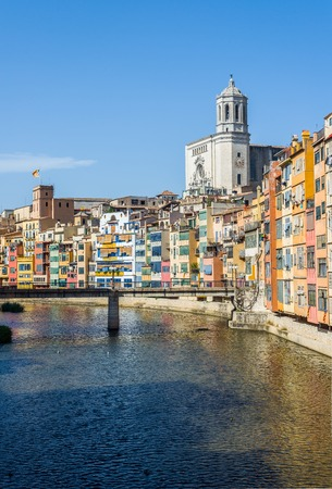 Onyar river crossing the downtown of Girona with Santa Maria cathedral in background. Gerona, Costa Brava, Catalonia, Spain.