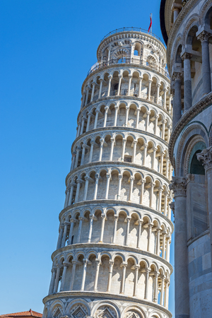 campanille: Leaning tower in Piazza dei Miracoli square of Pisa. Tuscany, Italy.