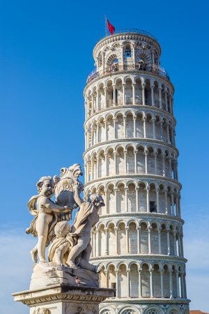 miracoli: Fontana dei Putti with leaning tower in background in Piazza dei Miracoli square of Pisa. Tuscany, Italy. Stock Photo