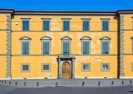 exterior shape: Principal facade of Palazzo delle Arcivescovado palace in Piazza Arcivescovado square of Pisa. Tuscany, Italy. Editorial