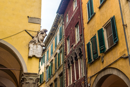 stone wall: Antique facade of a typical building in a Pisa street. Tuscany, Italy.