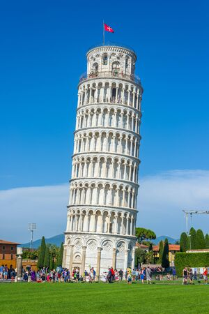campanille: Tourist waiting to visit the Leaning tower in Piazza dei Miracoli square of Pisa. Tuscany, Italy. Editorial