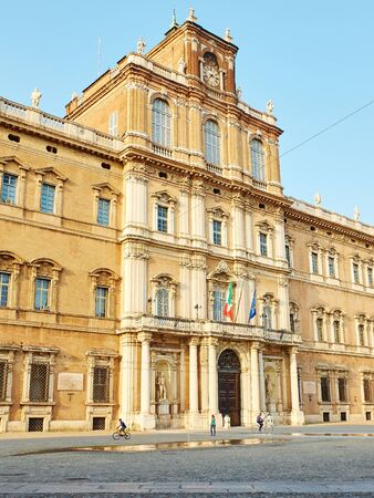 ducale: Modena, Italy - July 21, 2016. People walking in front of Palazzo Ducale in Piazza Roma of Modena. Emilia-Romagna. Italy. Editorial