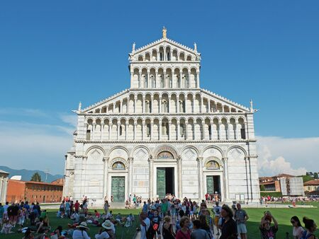 miracoli: Pisa, Italy - July 27, 2016. Tourist waiting to visit the Metropolitan Cathedral of Primaziale di Santa Maria Assunta in Piazza dei Miracoli square of Pisa. Tuscany, Italy.