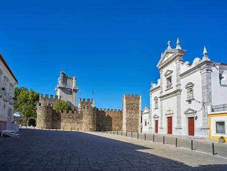 fortify: Beja, Portugal - November 30, 2016. Principal facade of Se catedral de Sao Tiago maior (Cathedral of St. James Major) and Castelo de Beja (Castle of Beja) in background. Beja, Alentejo. Portugal. Editorial