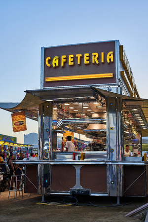 Mobile cafeteria and restaurant in the annual street fair of Palamos at sunset. Baix Emporda, Girona, Catalonia, Spain.