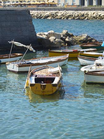 Fishing boats moored in Borgo Marinari, harbor of Megaride island. Naples. Campania, Italy.