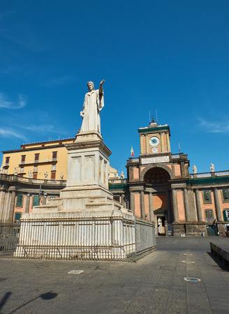 Monumento a Dante. Statue of Dante Alighieri in Piazza Dante with Foro Carolino in background. Naples, Campania, Italy.