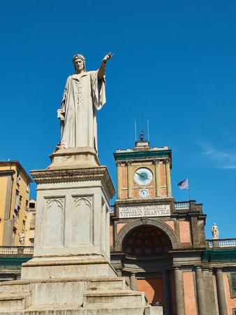 dante alighieri: Monumento a Dante. Statue of Dante Alighieri in Piazza Dante with Foro Carolino in background. Naples, Campania, Italy.