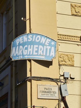 Naples, Italy - August 8, 2017. Pensione (Guest house) signboard in a street of Quartieri Vomero neighborhood of Naples, Campania, Italy.