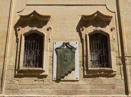 dante alighieri: Lecce, Italy - August 16, 2017. Bust of Dante Alighieri in the principal facade of Comune di Lecce, city hall, in Palazzo Carafa palace, Monastero delle Paolotte monastery of Lecce. Puglia, Italy.