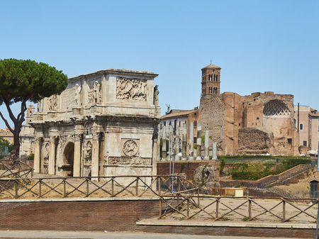 Arco de Constantino, Arch of Constantine, with Temple of Venus and Rome and Santa Francesca Romana bell tower in background.