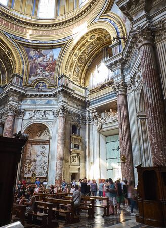Rome, Italy - August 19, 2017. Tourists in the nave of Santa Agnese in Agone. Rome, Lazio, Italy.