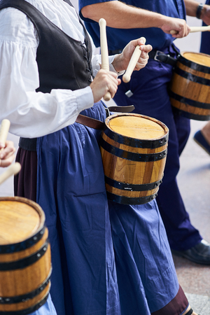 Citizens drumming in Tamborrada, the drum parade to commemorate the day that allied Anglo-Portuguese troops invaded the city. Basque Country, Guipuzcoa. Spain.
