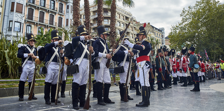 troop: San Sebastian, Spain - August 31, 2017. Soldiers stand in formation during Tamborrada, the drum parade to commemorate the day that Anglo-Portuguese troops invaded the city. Basque Country, Guipuzcoa.