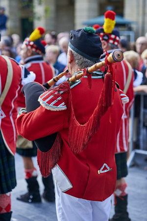 San Sebastian, Spain - August 31, 2017. Scottish troops playing bagpipe in Tamborrada, the drum parade to commemorate the day that allied Anglo-Portuguese troops invaded the city. Basque Country, Guipuzcoa. Spain.