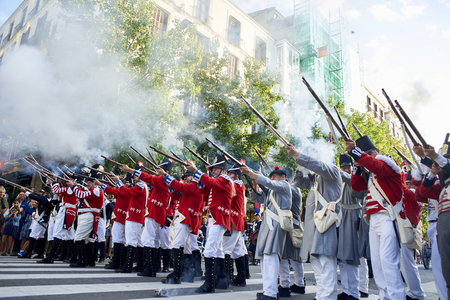 San Sebastian, Spain - August 31, 2017. Soldiers firing during Tamborrada, the drum parade to commemorate the day that Anglo-Portuguese troops invaded the city. Basque Country, Guipuzcoa.