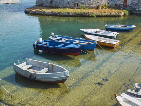 Fishing boats moored in fishing port of Gallipoli. Puglia, Italy. Stock Photo