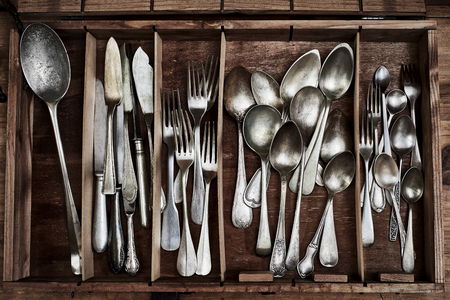 A Vintage service cutlery inside a rustic wooden box. 写真素材