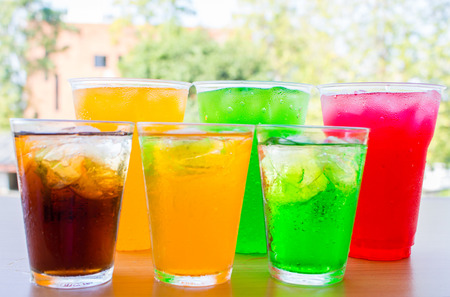 Colorful soft drinks in the glass.