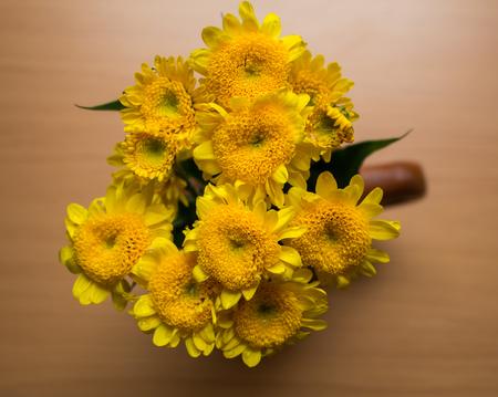 Yellow Chrysanthemum Vase On A Beige Background Stock Photo