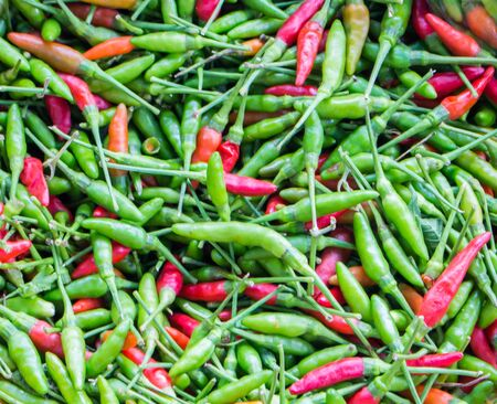 Fresh Chili that is both green and red.