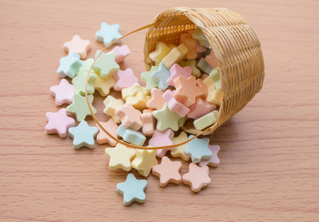 Milk Tablet Candy colorful stars In a wooden basket