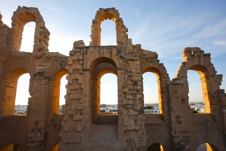 El Djem Amphitheatre arches with sunset Arches of roman biggest amphitheater, at sunset, in El Djam, Tunisia Stock Photo - 16113901