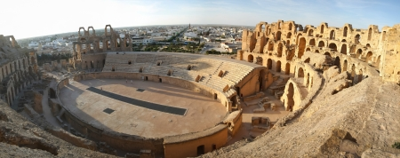 El Djem Amphitheatre panorama  Panorama of central podium and the whole roman amphitheater, with city skyline of El Djam in the background at sunset, Tunisia