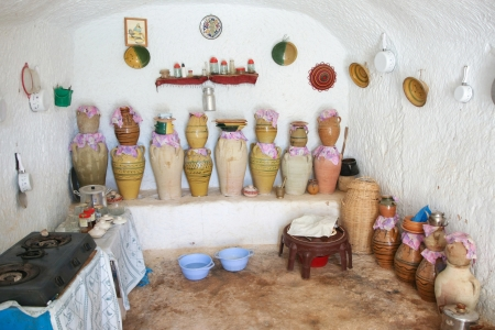 matmata: Matmata, Tunisia  The largest region of the troglodyte communities  One of many dwellings - fragment of courtyard excavated in the rock  circular crater a few meters deep  on September 17, 2012 in Matmata, Tunisia   Interior of kitchen in original troglod