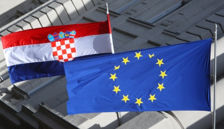 Zagreb,Croatia - May 29, 2013   European Union and Croatian flag on Government building, Zagreb,Croatia  Croatia state on 1 of July 2013 is becoming a full member of the European Union