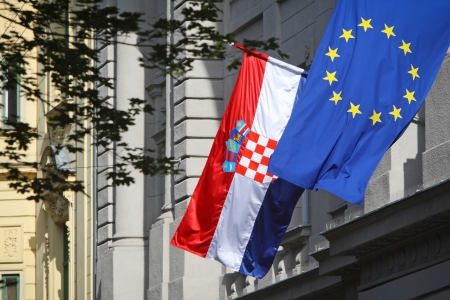 Zagreb,Croatia - May 29, 2013   European Union and Croatian flag on Government building, Zagreb,Croatia  Croatia state on 1 of July 2013 is becoming a full member of the European Union  報道画像