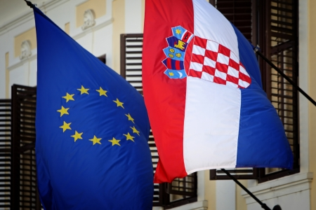Zagreb,Croatia - June 12, 2013   European Union and Croatian flag on Government building, Zagreb,Croatia  Croatia state on 1 of July 2013 is becoming a full member of the European Union  photo