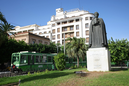 founding fathers: Tunis,Tunisia - September 14th, 2012   Statue of Ibn Khaldoun in front of the cathedral on Independence Square in Tunis,Tunisia  Ibn Khaldoun was an Arab Muslim historian and historiographer, regarded to be among the founding fathers of modern historiogra Editorial