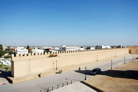 Tunis,Tunisia - September 16th, 2012   A street in Kairouan in front of the Great Mosque with a view on the city of Kairouan in Tunisia The Mosque is surrounded by walls separrating it from the rest of the city