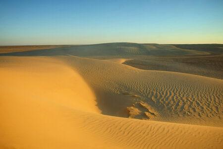Desert dunes of Sahara near Ong Jemel, Tozeur in Tunisia  Stock Photo