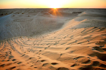 View at sunset on the dunes of Ong Jemel in the Sahara Desert in Tunisia