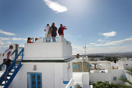 Sidi Bou Said, Tunisia - September 14th, 2012   Tourists photographing the view of the city from the highest terrace of El Annabi house, a typical residence in Sidi Bou Said, Tunisia  Sidi Bou Said is a town in northern Tunisia known for the use of blue a