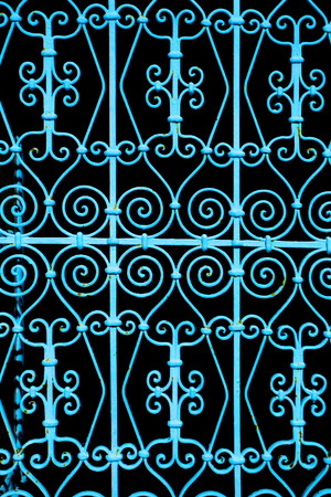 A detail of blue iron gates in a typical house in Sidi Bou Said,Tunisia  Sidi Bou Said is a town in northern Tunisia known for the use of blue and white in it Stock Photo