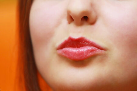 puckering lips: Young woman up close puckering her lips at the camera. Stock Photo