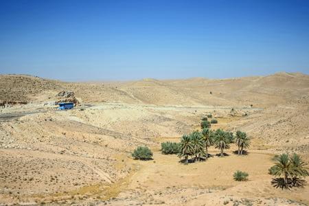 matmata: A bus passing through the Sahara desert in Matmata, Tunisia  Stock Photo