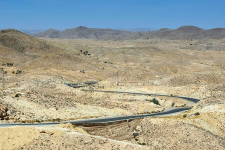 matmata: A road passing through the rocky Sahara desert in Matmata, Tunisia