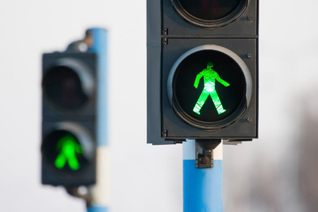 Green lights for pedestrians on two semaphores in traffic  Stock Photo