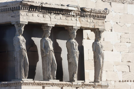 caryatids: The caryatids in the Erechtheion of  Erechtheum, the ancient greek temple in the Acropolis of Athens in Athens, Greece.