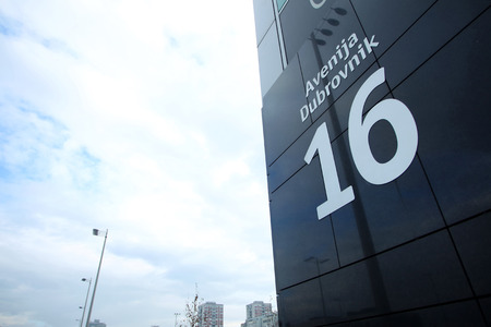 number 16: ZAGREB, CROATIA - JANUARY 3 : A close up of address home number 16 on the building of Avenue Mall on January 3rd, 2014 in Zagreb, Croatia. Avenue Mall is a popular shopping centre in Zagreb, Croatia.